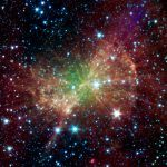 "Looking like a piece of cosmic workout equipment, the ""Dumbbell Nebula,"" also known as M27, pumps out infrared light in this image from NASA's Spitzer Space Telescope. Discovered in 1764, Charles Messier included it as the 27th member of his famous"
